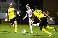 Bolton Wanderers' Brandon Fleming (centre) breaks through Burton Albion's Jamie Murphy (left) and  Lucas Akins <br /> <br /> Photographer Andrew Kearns/CameraSport<br /> <br /> The Premier League - Leicester City v Aston Villa - Monday 9th March 2020 - King Power Stadium - Leicester<br /> <br /> World Copyright © 2020 CameraSport. All rights reserved. 43 Linden Ave. Countesthorpe. Leicester. England. LE8 5PG - Tel: +44 (0) 116 277 4147 - admin@camerasport.com - www.camerasport.com