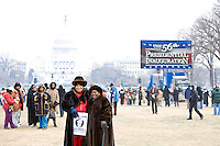 People pose for pictures on the Capitol grounds in Washington D.C. on January 19th, 2009, where Barack Obama is set to be sworn in as the 44th President of the United States the following day.