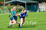Maggie West Laune Rangers is tackled by Sarah Leahy Legion during their Junior A Championship game in Direen on Sunday