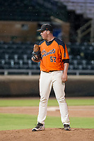 AZL Giants relief pitcher John Gavin (57) looks to his catcher for the sign during Game Three of the Arizona League Championship Series against the AZL Cubs on September 7, 2017 at Scottsdale Stadium in Scottsdale, Arizona. AZL Cubs defeated the AZL Giants 13-3 to win the series two games to one. (Zachary Lucy/Four Seam Images)
