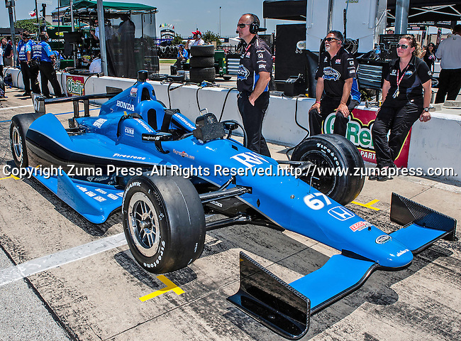 The Sarah Fisher Hartman Racing car in action during qualifying for the IZOD Indycar Firestone 550 race at Texas Motor Speedway in Fort Worth,Texas. IZOD Indycar driver Alex Tagliani (98) driver of the Team Barracuda-BHA car qualifies in the top spot during the Firestone 550 race..