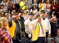 """Janelle Jessen/Herald-Leader<br /> Veterans salute as the Siloam Springs High School band member plays """"Taps"""" during the community Veterans Day program on Monday. The high school and Veterans of Foreign Wars Post 1674 partnered to host the event."""