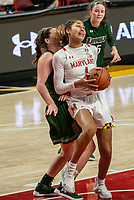 COLLEGE PARK, MD - DECEMBER 8: Shakira Austin #1 of Maryland backs into Stephanie Karcz #10 of Loyola during a game between Loyola University and University of Maryland at Xfinity Center on December 8, 2019 in College Park, Maryland.