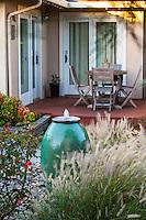 Bubbling urn water fountain in small space backyard garden; Lundstrom Garden, design by Susan Morrison