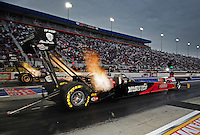 Sept. 16, 2011; Concord, NC, USA: NHRA top fuel dragster driver Rod Fuller (near lane) races alongside Clay Millican during qualifying for the O'Reilly Auto Parts Nationals at zMax Dragway. Mandatory Credit: Mark J. Rebilas-US PRESSWIRE