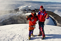Succesful mountain climbers on the summit of Mount Cotopaxi, a 5,897 meter ( 19,348 feet ) high active volcano near Quito, Ecuador.  Model Released