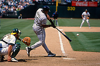 OAKLAND, CA:  Frank Thomas of the Chicago White Sox bats during a game against the Oakland Athletics at the Oakland Coliseum in Oakland, California in 1998. (Photo by Brad Mangin)