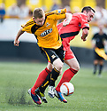 Alloa's James Doyle and East Fife's Gareth Wardlaw challenge for the ball.