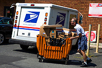 NORTH BERGEN, NJ - AUGUST 17: A worker loads a truck outside the United States Postal Service office on August 17, 2020 in North Bergen New Jersey. Mail Delays Fuel Concern Trump Is Undercutting Postal System before elections , Mail-in voting across the country has led to a series of anomalous results in recent weeks (Photo by Kena Betancur/ VIEWpress via Getty Images)