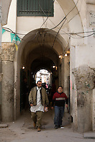 Tripoli, Libya - Roman Columns Incorporated into Later Construction, Medina (Old City).  Man Wears Traditional Libyan Vest, Boy Wears Western Clothes.