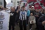 Newcastle United 1 Tottenham Hotspur 3 19/04/2015. St James Park, Premier League. Protestors holding signs and chanting during a demonstration at the Gallowgate end of the stadium before Newcastle United host Tottenham Hotspurs in an English Premier League match at St. James' Park. The match was boycotted by a section of the home support critical of the role of owner Mike Ashley and sponsorship by a payday loan company. The match was won by Spurs by 3-1, watched by 47,427, the lowest league gate of the season at the stadium. Photo by Colin McPherson.