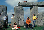 1970's style hippies attend the first free festival at Stonehenge to celebrate the summer solstice June 21st 1979 Besides the hippies a small group of tourists came to watch the celebrations over the three day festival.