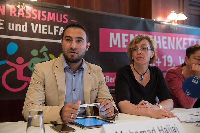"""Pressekonferenz zur Menschenketten-Aktion """"Hand in Hand gegen Rassismus"""" am 18. und 19. Juni 2016 in vielen Staedten in ganz Deutschland stattfindet.<br /> Im Bild vlnr.: Mohamad Hajjaj (Zentralrat der Muslime in Deutschland); Dr. Andrea Berg (Amnesty International in Deutschland). <br /> 14.6.2016, Berlin<br /> Copyright: Christian-Ditsch.de<br /> [Inhaltsveraendernde Manipulation des Fotos nur nach ausdruecklicher Genehmigung des Fotografen. Vereinbarungen ueber Abtretung von Persoenlichkeitsrechten/Model Release der abgebildeten Person/Personen liegen nicht vor. NO MODEL RELEASE! Nur fuer Redaktionelle Zwecke. Don't publish without copyright Christian-Ditsch.de, Veroeffentlichung nur mit Fotografennennung, sowie gegen Honorar, MwSt. und Beleg. Konto: I N G - D i B a, IBAN DE58500105175400192269, BIC INGDDEFFXXX, Kontakt: post@christian-ditsch.de<br /> Bei der Bearbeitung der Dateiinformationen darf die Urheberkennzeichnung in den EXIF- und  IPTC-Daten nicht entfernt werden, diese sind in digitalen Medien nach §95c UrhG rechtlich geschuetzt. Der Urhebervermerk wird gemaess §13 UrhG verlangt.]"""
