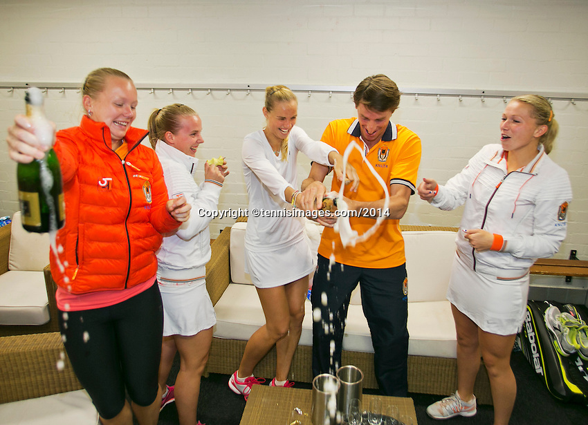 The Netherlands, Den Bosch, 20.04.2014. Fed Cup Netherlands-Japan, The Dutch team celebrates with champ[agne, l.t.r.: Kiki Bertens,Rachel Hogenkamp,Arantxa Rus, captain Paul Haarhuis and Michaella Krajicek<br /> Photo:Tennisimages/Henk Koster