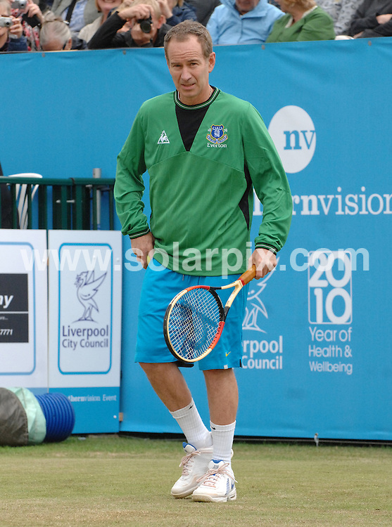 **ALL ROUND PICTURES FROM SOLARPIX.COM**.**WORLDWIDE SYNDICATION RIGHTS**.John McEnroe, Martina Hingis and Amy Askew at Liverpool tennis tournament, Calderstones Park, Liverpool, UK.18 June 2010..This pic: John McEnroe..JOB REF: 11516 SGD     DATE: 18_06_2010.**MUST CREDIT SOLARPIX.COM OR DOUBLE FEE WILL BE CHARGED**.**MUST NOTIFY SOLARPIX OF ONLINE USAGE**.**CALL US ON: +34 952 811 768 or LOW RATE FROM UK 0844 617 7637**