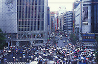 People with umbrellas cross the Shibuya crossing, central Tokyo, Japan. Shibuya is one of the 23 special wards of Tokyo and is known as one of the fashion centers of Japan, particularly for young  people, and as a major nightlife area..21 Jul 2000