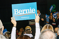 A person holds up a Bernie campaign sign as Democratic New Hampshire governor candidate Andru Volinsky speaks at a campaign rally for Democratic presidential candidate and Vermont senator Bernie Sanders at Hampshire Hills Athletic Club in Milford, New Hampshire, on Tue., Feb. 4, 2020. The  event started around 7pm and was the first event Sanders held after the previous day's Iowa Caucuses. The results of the caucuses were unknown until the Democratic party released partial numbers at 5pm, showing Sanders and former South Bend, Ind., mayor Pete Buttigieg both as frontrunners. Volinsky is the first governor candidate to be endorsed by Sanders.