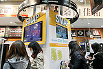 Fans look at an exhibit space for the SMAP's new album SMAP 25 YEARS at the Tsutaya store in Shibuya on December 22, Tokyo, Japan. Japan's most popular boy band announced that they would split by the end of the year, and the special album includes 50 of the band's songs as selected by fans. (Photo by Rodrigo Reyes Marin/AFLO)
