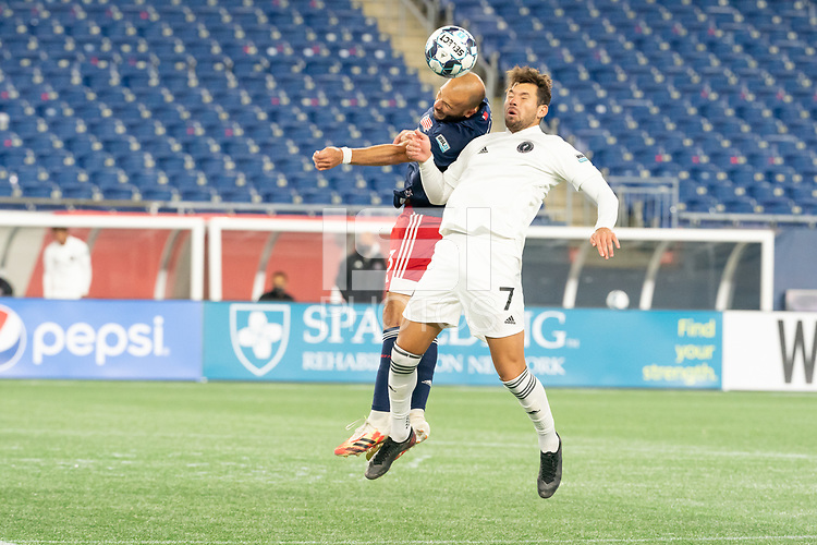 FOXBOROUGH, MA - OCTOBER 09: Tiago Mendonca #33 of New England Revolution II and Ricky Lopez-Espin #7 of Fort Lauderdale CF compete for a high ball during a game between Fort Lauderdale CF and New England Revolution II at Gillette Stadium on October 09, 2020 in Foxborough, Massachusetts.