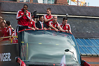 CARDIFF, UK. 8th July 2016. The Welsh football team are welcomed home with a public celebration event after reaching the semi-final of the Euro 2016 championship. After landing at Cardiff airport, an open-top bus parade took them through the city centre.<br /> <br /> L-R: Ashley Williams, Gareth Bale (hidden), Chris Coleman, Chris Gunter (standing), Aaron Ramsey, Wayne Hennessey