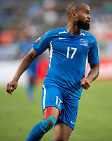 DENVER, CO - JUNE 19: Etages Kevin Parsemain #17 attacks during a game between Martinique and Cuba at Broncos Stadium on June 19, 2019 in Denver, Colorado.