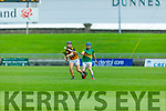 Abbeydorney's P.J. Keane about to take possession as  Brian McAuliffe of Lixnaw puts in a challenge in the Senior Hurling Championship quarter final.