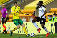 20th February 2021; Carrow Road, Norwich, Norfolk, England, English Football League Championship Football, Norwich versus Rotherham United; Kenny McLean of Norwich City challenges Freddie Ladapo of Rotherham United
