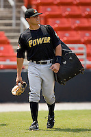 Tony Sanchez #29 of the West Virginia Power brings his gear to the visitors dugout at L.P. Frans Stadium August 9, 2009 in Hickory, North Carolina. (Photo by Brian Westerholt / Four Seam Images)