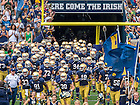 Aug. 30, 2014; The football team runs out of the tunnel before the game against Rice..Photo by Matt Cashore