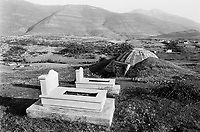 Albania. Province of Kukes. Morin. Bunker and graveyard. Horin is 20 km from the Kosovo border. Enver Hoxha (1908-1985) was for 40 years a dictator and a communist leader. He decided after the historic break with Russia in 1961 to protect his country from any invaders by investing in a massive fortification (more than a million bunkers were built over the years till 1985).  © 2003 Didier Ruef