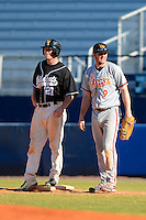University of Missouri - St Louis Tritons first baseman Charlie Mohr #9 and C.J. Nolen #21 during a game against the Wayne State Wildcats at Chain of Lakes Stadium on March 8, 2013 in Winter Haven, Florida.  Wayne State defeated UMSL 3-2 in fourteen innings.  (Mike Janes/Four Seam Images)