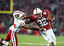 PASADENA, CA - January 1, 2013: Stanford running back Anthony Wilkerson (32) gives a stiff arm during the Stanford Cardinal vs the Wisconsin Badgers game in the 2013 Rose Bowl Game in Pasadena, California. Final score Stanford 20, Wisconsin 14.