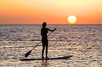 Standup paddler at sunset at Olowalu, Maui, Hawaii, USA.