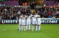 Sunday 09 November 2014 <br /> Swansea players huddle before kick off<br /> Barclays Premier League, Swansea City FC v Arsenal City at the Liberty Stadium, Swansea, Great Britain.