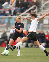 Allie Long (blue) of the Washington Freedom passes the ball in front of Yael Averbuch  of Sky Blue F.C. during a WPS pre season match at Maryland Soccerplex, in Boyd's, Maryland on March 14 2009. Sky Blue won the match 1-0