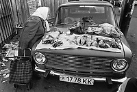 Russia. Krasnodar Krai Region. Krasnodar. City center. Open-air street market. The body of a Lada car is used as a meat stall. Pig's head and raw meat for sale. An elderly woman checks the meat's quality and its freshness. LADA is a brand of cars manufactured by AvtoVAZ (originally VAZ), a Russian company owned by the French Groupe Renault. Krasnodar (also known as Kuban) is the largest city and the administrative centre of Krasnodar Krai in Southern Russia. 25.09.1993 © 1993 Didier Ruef