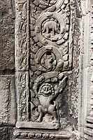 Cambodia.  Ta Prohm Temple Ruins, 12th-13th. Century.  Apparent Stegosaurus Carved in Side Panel; Lion at Bottom.