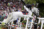 August 08, 2009: Jur Vrieling (NED) aboard Pegasus competing in the Puissance event. Land Rover International Puissance. Failte Ireland Horse Show. The RDS, Dublin, Ireland.