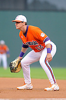 First baseman Jon McGibbon (12) of the Clemson Tigers in a fall scrimmage against College Lafleche from Canada on October 17, 2013, at Fluor Field at the West End in Greenville, South Carolina. (Tom Priddy/Four Seam Images)