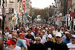 Runners continue on South Street before turning north on Sixth Street during the Philadelphia Marathon in Philadelphia, Pennsylvania on November 19, 2006.