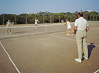Chateau Resort, Provincetown, Cape Cod, MA. Tennis doubles match with two couples playing with old wooden tennis rackets