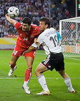 Michal Zewlakow of Poland in action against Bernd Schneider of Germany at FIFA World Cup Stadium, Dortmund, Germany, June 14, 2006.