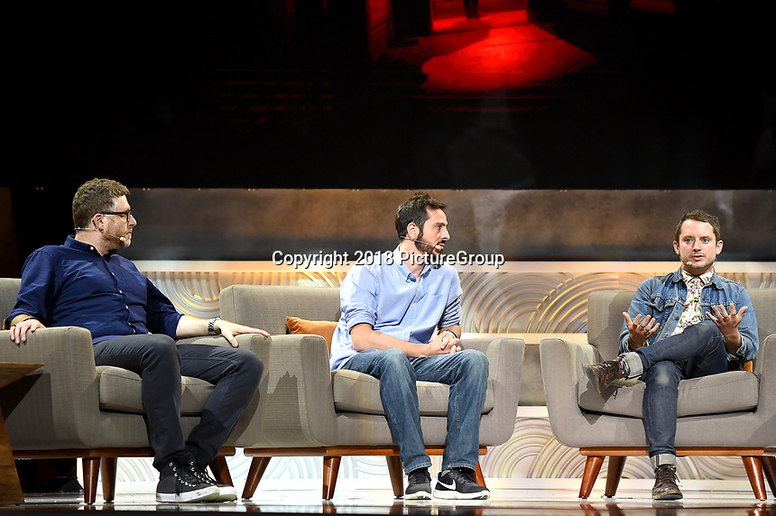 """LOS ANGELES - JUNE 12: L-R: """"Transference with Elijah Wood"""" -  Partner, Head of Development/Co-Writer Company X/SpectreVision Daniel Noah, Producer, Ubisoft Montreal Kevin Racape and actor Elijah Wood speak onstage at the E3 Coliseum event at the The Novo at L.A. Live on June 12, 2018 in Los Angeles, California. (Photo by Frank Micelotta/PictureGroup)"""