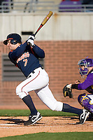 John Barr #7 of the Virginia Cavaliers follows through on his swing versus the East Carolina Pirates at Clark-LeClair Stadium on February 19, 2010 in Greenville, North Carolina.   Photo by Brian Westerholt / Four Seam Images