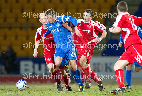 St Johnstone v Brechin....22.03.11  Scottish Cup Quarter Final replay.Murray Davidson battles with Craig Molloy.Picture by Graeme Hart..Copyright Perthshire Picture Agency.Tel: 01738 623350  Mobile: 07990 594431