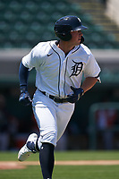 Detroit Tigers Spencer Torkelson (19) runs to first base during a Minor League Spring Training game against the Baltimore Orioles on April 14, 2021 at Joker Marchant Stadium in Lakeland, Florida.  (Mike Janes/Four Seam Images)