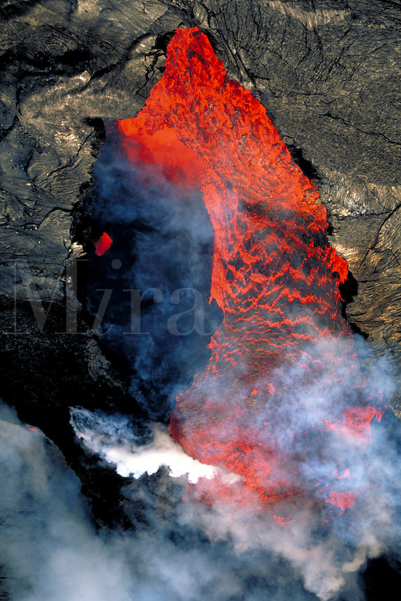 Kilauea Volcano - lava exploding from splatter cone inside of Pu'u' o'o vent. Hawaii, Volcanoes National Park.