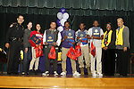 Inspired for Excellence Academy staff members join Sheriff Adrian Garcia on stage with Kindle Fire-winning students (from left) Mariela Lagunes, William Hernandez, Oscar Cooper, Devin Pickens, and Joseph Linsey.