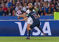 PARIS,  - JUNE 28: Lindsey Horan #9 moves past Élise Bussaglia #15 during a game between France and USWNT at Parc des Princes on June 28, 2019 in Paris, France.