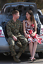 Marine Lance Cpl. Dan Pedry relaxes with his wife Courtney on the edge of the trunk of their car in 2007 after reuniting at Camp Pendleton after his deployment to Iraq.  photo for the North County Times